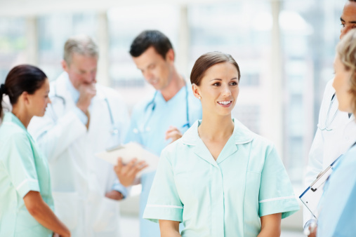 Doctors and nurses discussing against blur background